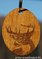 wooden key chain laser engraved with a white tail buck from Chris Terwilliger's original art work
