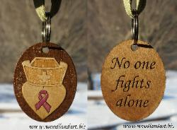 custom laser engraved hand painted key chains for cancer benefit. No one fights alone.